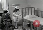 Image of child suffers from tuberculosis Detroit Michigan USA, 1936, second 44 stock footage video 65675023152