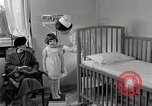 Image of child suffers from tuberculosis Detroit Michigan USA, 1936, second 45 stock footage video 65675023152