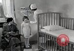 Image of child suffers from tuberculosis Detroit Michigan USA, 1936, second 46 stock footage video 65675023152