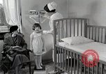 Image of child suffers from tuberculosis Detroit Michigan USA, 1936, second 47 stock footage video 65675023152