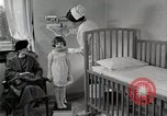 Image of child suffers from tuberculosis Detroit Michigan USA, 1936, second 48 stock footage video 65675023152