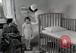 Image of child suffers from tuberculosis Detroit Michigan USA, 1936, second 49 stock footage video 65675023152