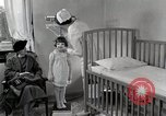 Image of child suffers from tuberculosis Detroit Michigan USA, 1936, second 52 stock footage video 65675023152
