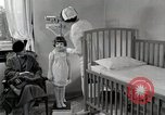 Image of child suffers from tuberculosis Detroit Michigan USA, 1936, second 53 stock footage video 65675023152