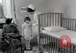 Image of child suffers from tuberculosis Detroit Michigan USA, 1936, second 54 stock footage video 65675023152