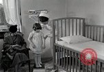 Image of child suffers from tuberculosis Detroit Michigan USA, 1936, second 55 stock footage video 65675023152
