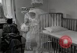 Image of child suffers from tuberculosis Detroit Michigan USA, 1936, second 56 stock footage video 65675023152
