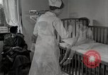 Image of child suffers from tuberculosis Detroit Michigan USA, 1936, second 57 stock footage video 65675023152