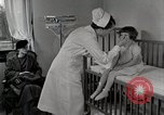 Image of child suffers from tuberculosis Detroit Michigan USA, 1936, second 58 stock footage video 65675023152