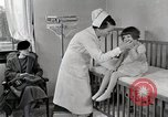 Image of child suffers from tuberculosis Detroit Michigan USA, 1936, second 61 stock footage video 65675023152
