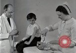 Image of Doctor vaccinates boy Detroit Michigan USA, 1936, second 7 stock footage video 65675023153