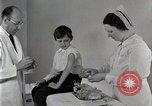 Image of Doctor vaccinates boy Detroit Michigan USA, 1936, second 10 stock footage video 65675023153