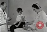Image of Doctor vaccinates boy Detroit Michigan USA, 1936, second 11 stock footage video 65675023153