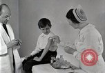 Image of Doctor vaccinates boy Detroit Michigan USA, 1936, second 16 stock footage video 65675023153