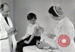 Image of Doctor vaccinates boy Detroit Michigan USA, 1936, second 17 stock footage video 65675023153