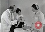 Image of Doctor vaccinates boy Detroit Michigan USA, 1936, second 21 stock footage video 65675023153