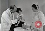 Image of Doctor vaccinates boy Detroit Michigan USA, 1936, second 22 stock footage video 65675023153