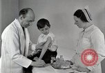 Image of Doctor vaccinates boy Detroit Michigan USA, 1936, second 24 stock footage video 65675023153