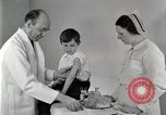 Image of Doctor vaccinates boy Detroit Michigan USA, 1936, second 25 stock footage video 65675023153