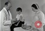 Image of Doctor vaccinates boy Detroit Michigan USA, 1936, second 27 stock footage video 65675023153