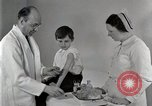 Image of Doctor vaccinates boy Detroit Michigan USA, 1936, second 28 stock footage video 65675023153