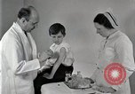 Image of Doctor vaccinates boy Detroit Michigan USA, 1936, second 29 stock footage video 65675023153
