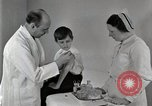 Image of Doctor vaccinates boy Detroit Michigan USA, 1936, second 30 stock footage video 65675023153