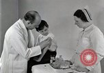 Image of Doctor vaccinates boy Detroit Michigan USA, 1936, second 33 stock footage video 65675023153
