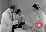 Image of Doctor vaccinates boy Detroit Michigan USA, 1936, second 35 stock footage video 65675023153