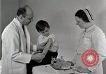 Image of Doctor vaccinates boy Detroit Michigan USA, 1936, second 36 stock footage video 65675023153