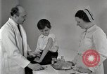 Image of Doctor vaccinates boy Detroit Michigan USA, 1936, second 37 stock footage video 65675023153