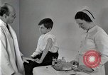 Image of Doctor vaccinates boy Detroit Michigan USA, 1936, second 38 stock footage video 65675023153