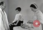 Image of Doctor vaccinates boy Detroit Michigan USA, 1936, second 39 stock footage video 65675023153
