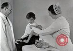 Image of Doctor vaccinates boy Detroit Michigan USA, 1936, second 40 stock footage video 65675023153