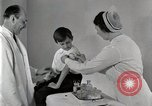 Image of Doctor vaccinates boy Detroit Michigan USA, 1936, second 41 stock footage video 65675023153