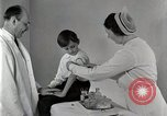 Image of Doctor vaccinates boy Detroit Michigan USA, 1936, second 43 stock footage video 65675023153