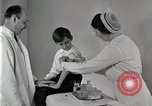 Image of Doctor vaccinates boy Detroit Michigan USA, 1936, second 45 stock footage video 65675023153