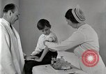 Image of Doctor vaccinates boy Detroit Michigan USA, 1936, second 46 stock footage video 65675023153