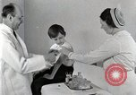 Image of Doctor vaccinates boy Detroit Michigan USA, 1936, second 48 stock footage video 65675023153