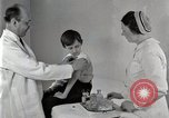 Image of Doctor vaccinates boy Detroit Michigan USA, 1936, second 49 stock footage video 65675023153