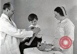 Image of Doctor vaccinates boy Detroit Michigan USA, 1936, second 50 stock footage video 65675023153