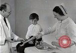 Image of Doctor vaccinates boy Detroit Michigan USA, 1936, second 53 stock footage video 65675023153