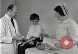 Image of Doctor vaccinates boy Detroit Michigan USA, 1936, second 54 stock footage video 65675023153