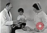 Image of Doctor vaccinates boy Detroit Michigan USA, 1936, second 55 stock footage video 65675023153