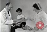 Image of Doctor vaccinates boy Detroit Michigan USA, 1936, second 56 stock footage video 65675023153