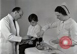 Image of Doctor vaccinates boy Detroit Michigan USA, 1936, second 58 stock footage video 65675023153