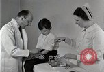 Image of Doctor vaccinates boy Detroit Michigan USA, 1936, second 59 stock footage video 65675023153