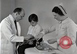 Image of Doctor vaccinates boy Detroit Michigan USA, 1936, second 62 stock footage video 65675023153