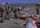 Image of Astronauts survival training Nevada United States USA, 1960, second 34 stock footage video 65675023343