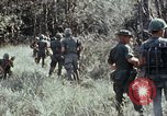 Image of jungle trail Vietnam, 1968, second 31 stock footage video 65675030468